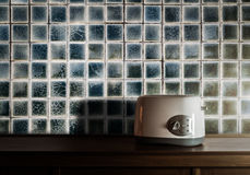 Toaster on wooden cupboard in kitchen room Royalty Free Stock Photography