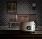 Toaster on wooden cupboard Royalty Free Stock Photography