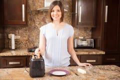Toasting bread for breakfast Stock Photos