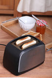 Toasting bread for breakfast Royalty Free Stock Images