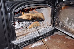Toasting bred. The old-fashion way against the fire in a wood-stove Royalty Free Stock Images