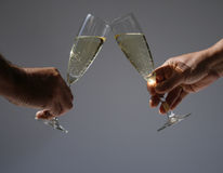 Toasting with champagne. Toasting with two glasses of champagne Royalty Free Stock Photography