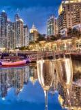 Toasting with champagne against Dubai marina in United Arab Emirates Stock Images
