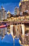 Toasting with champagne against Dubai marina in United Arab Emirates Stock Image