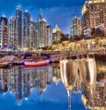 Toasting with champagne against Dubai marina in United Arab Emirates Royalty Free Stock Image