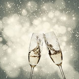 Toasting with champagne glasses. On sparkling holiday background Stock Image