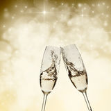 Toasting with champagne glasses. On sparkling holiday background Royalty Free Stock Photos