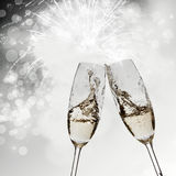 Toasting with champagne glasses. On sparkling holiday background Royalty Free Stock Images