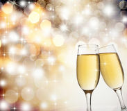 Toasting with champagne glasses. On sparkling holiday background Royalty Free Stock Photography