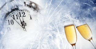 Toasting with champagne glasses. On sparkling holiday background Stock Photo