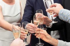 Toasting Champagne. Group of people with elegant clothing celebrating and toasting champagne glasses Royalty Free Stock Photography