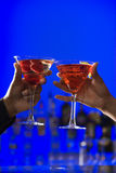 Toasting Cocktails in Martini Glasses Stock Images