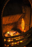 Toasting By The Fire. Bread being toasted by an open coal fire in Winter Stock Photos