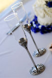 Toasting Flutes. A close up on two toasting flutes sitting on a table next to a wedding cake stock photos