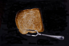 Toasting fork. Old style toasting fork with slice of toast Royalty Free Stock Photography