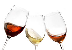 Toasting gesture red and white wine with splash, cheers close up with wine isolated Stock Photo