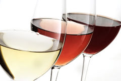 Toasting gesture red and white wine with splash, cheers close up with wine isolated Stock Images
