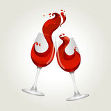 Toasting gesture two red wine glasses. With big splash Stock Image