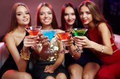 Toasting girls Royalty Free Stock Images