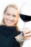 Toasting with a glass of red wine. Stock Photos
