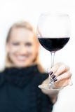 Toasting with a glass of red wine. Royalty Free Stock Photo