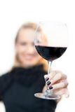 Toasting with a glass of red wine. Royalty Free Stock Photography