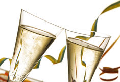 Toasting on new year's eve. Close-up two glasses of champagne, new year's eve decoration in background Stock Photos
