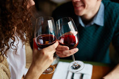Toasting with red wine Stock Photos