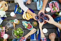 Toasting with red wine Royalty Free Stock Images