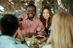 Toasting by table Royalty Free Stock Image