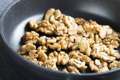 Toasting Walnuts. Stock Photos