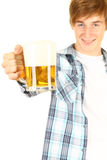 Toasting young man with beer Stock Photos