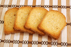 Toasts 2. Image of some toast laid on a straw mat Royalty Free Stock Photo