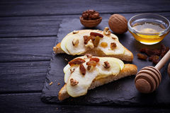 Toasts with apple, walnuts, raisin and honey. Selective focus Royalty Free Stock Photography
