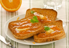 Toasts with apricot jam and butter Stock Photos