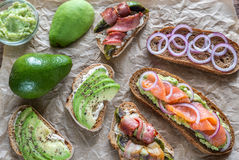 Toasts with avocado and different toppings Royalty Free Stock Photos