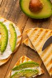 Toasts with avocado, on wooden background, delicious breakfast stock photos