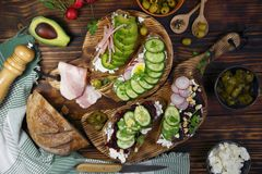 Toasts with avocados,beets and ham. Toasts with avocados,beets,radishes and ham stock photos