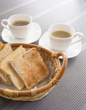 Toasts in basket Breakfast set with coffee Stock Photography