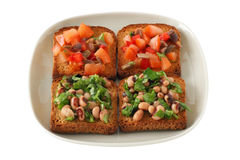 Toasts with beans and tomato Royalty Free Stock Image