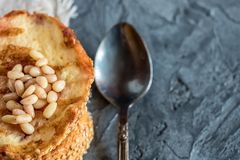Toasts of bread with sesame seeds homemade cake in stack decorated with pine nut on linen cotton napkin Royalty Free Stock Photo