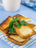 Toasts on breakfast and a cup of coffee. Toasts on breakfast, decorated with parsley, and a cup of coffee Stock Images