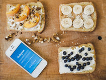 Toasts for breakfast and phone with Instagram on wooden background Stock Photography