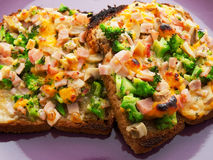 Toasts with broccoli and cheese Royalty Free Stock Images