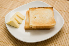 Toasts and butter Royalty Free Stock Images