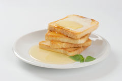 Toasts with butter and honey Stock Image