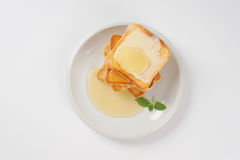 Toasts with butter and honey Royalty Free Stock Photos