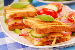 Toasts with cheese,bacon and tomato Royalty Free Stock Image