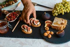 Toasts of cheese, figs and honey on whole-grain crispy bread. Close up. concept of Italian cuisine royalty free stock images