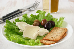 Toasts with cheese and olives Royalty Free Stock Images